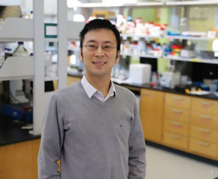 Zhen Ma poses for a photograph in his scientific laboratory.