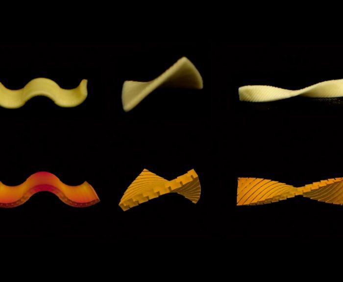 Six folding pasta shapes on a black background